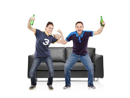 kibitz: Excited boy and girl watching sport Stock Photo
