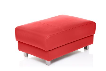 footstool: A view of a red footstool isolated against white background