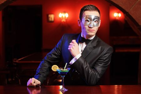 A man with a mask on a counter bar  photo
