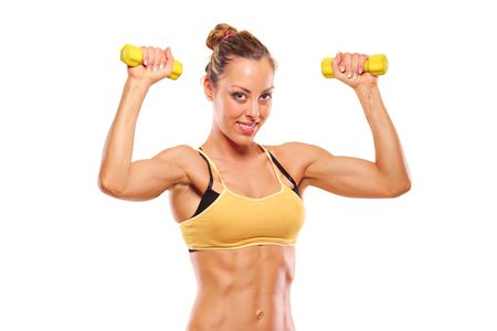 Young attractive woman with weights isolated on white background photo