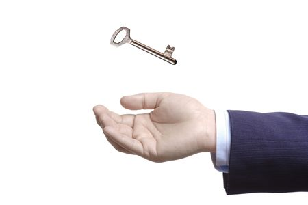 doorkey: A hand and a key isolated on white background