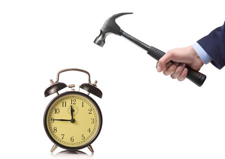 old items: A man about to break an alarm clock Stock Photo