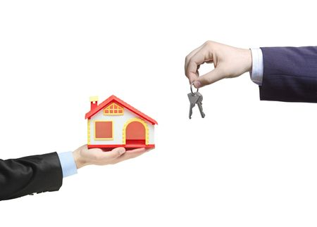 Real estate agent holding keys from your new house Stock Photo - 7230868