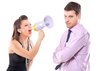 Young couple quarreling isolated against white background Stock Photo - 7240614