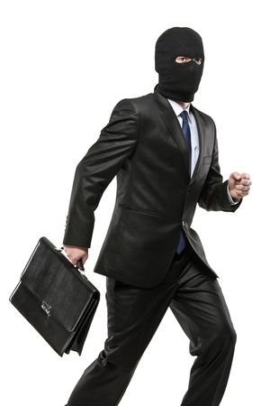 A man in robbery mask carrying a briefcase isolated on white background photo