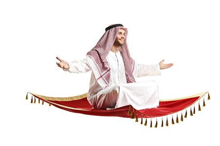 headcloth: An arab person sitting on a flying carpet isolated on white background