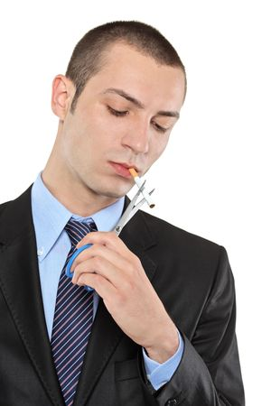 A man cutting a cigarette with scissors isolated on white background photo