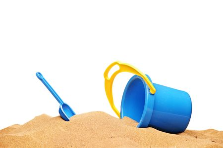 golden shovel: A view of a basket and scoop at the beach isolated on white background