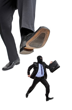affraid: An affraid burglar running away from a big foot isolated on white background