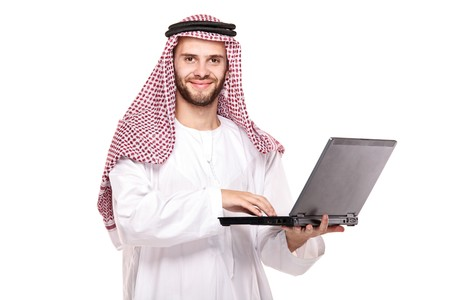 arab man: An arab person working on laptop isolated on white background
