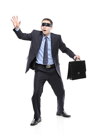 Confused blindfold businessman with briefcase isolated on white background Stock Photo - 7372098