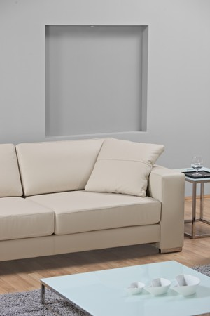 A studio shot of a white leather sofa ATTENTION !!! This is studio shot, not required property release photo