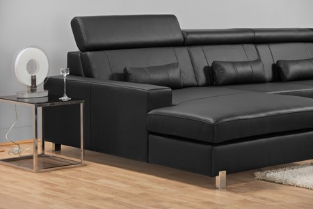 A studio shot of a black leather sofa ATTENTION !!! This is studio shot, not required property release photo