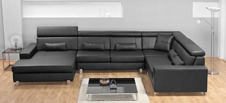 A studio shot of a black leather sofa ATTENTION !!! This is studio shot, not required property release Stock Photo - 7423449