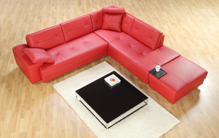 view of an elegant red couch: A studio shot of modern red sofa and table, do not need property release Stock Photo