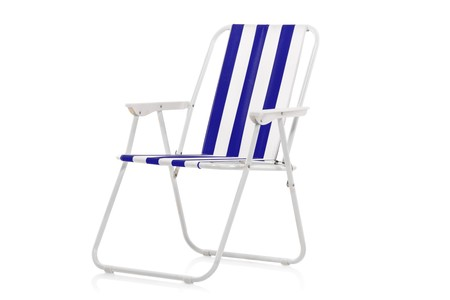 Blue and white striped beach chair isolated on white background photo