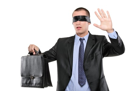 Confused blindfold businessman with briefcase isolated on white background photo