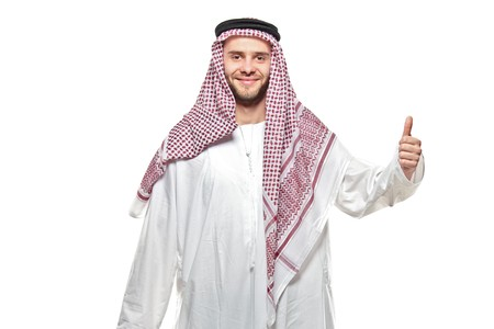 confirm confirmation: An arab person with a thumbs up isolated on white background