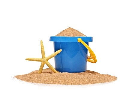 A view of a bucket and a yellow starfish isolated on white background photo