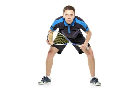 Squash player preparing for service isolated on white background photo