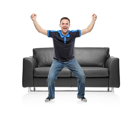 A view of a happy sport fan against white background Stock Photo - 7561815