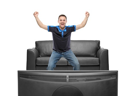 agitated: A sport fan watching TV Stock Photo