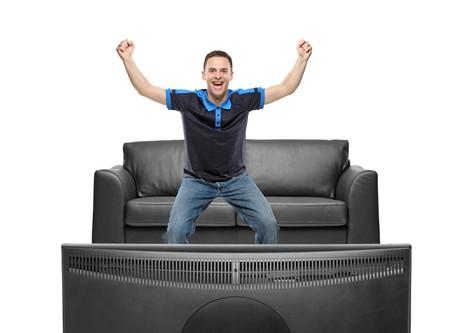observer: A sport fan watching TV Stock Photo