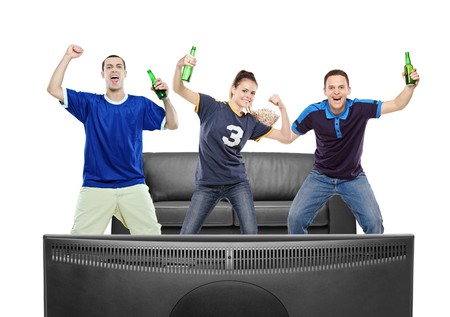 Three sport fans watching TV against white background photo