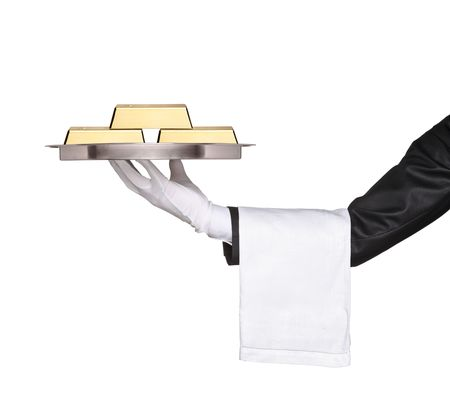 A waiter holding a tray with gold bars on it against white background photo