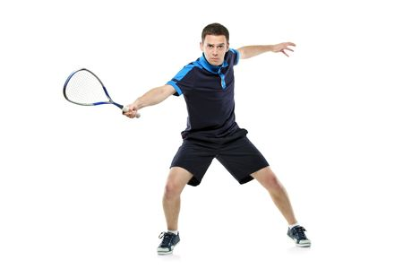 sportman: A squash player playing against white background
