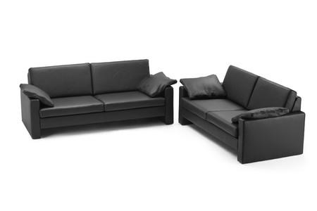Black leathered furniture isolated on white background photo