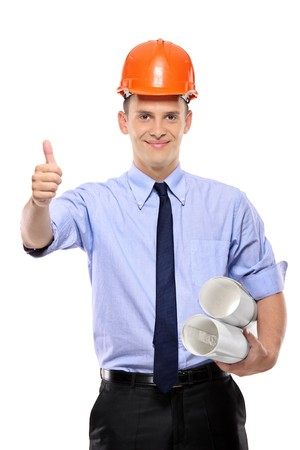 Construction worker holding blueprints and giving thumbs-up against white background photo