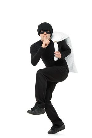 ladron: Penal huir llevando una bolsa aislada sobre fondo blanco  Foto de archivo