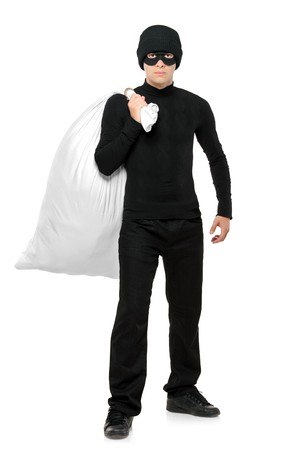 Full length portrait of a Thief holding a bag isolated against white background Stock Photo - 7776151