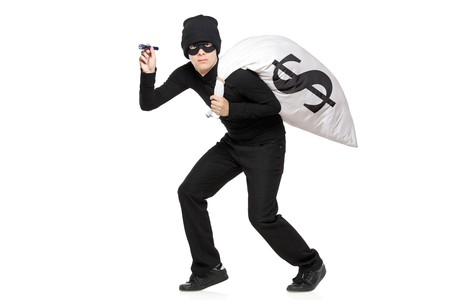 con man: Thief with a bag and flashlight in hands isolated against white background Stock Photo