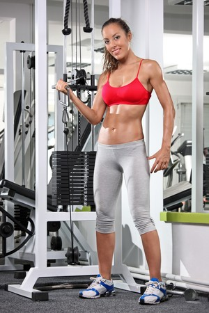 A woman working out on a fitness equipment at the gym photo