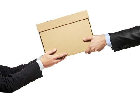 A businessman delivering a package to a man isolated on white background photo