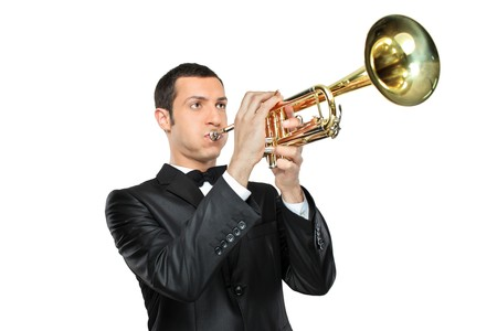Trumpets: A young man in suit playing a trumpet isolated on white background Stock Photo