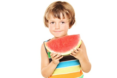 A young boy holding a slice of watermelon isolated against  white background photo