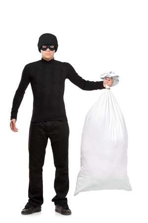 shoplifter: A robbery man holding a bag isolated on white background