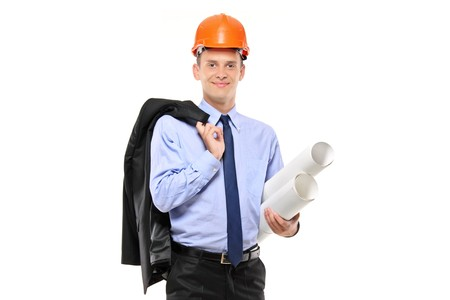 A view of a foreman wearing helmet and holding blueprints isolated on white background photo