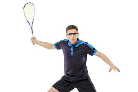 A view of a squash player posing against white background photo
