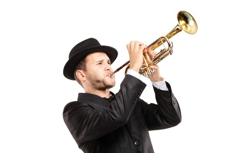rehearse: A man in a suit with a hat playing a trumpet isolated on white background
