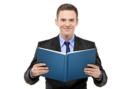 man holding book: A young businessman reading a book isolated on white background
