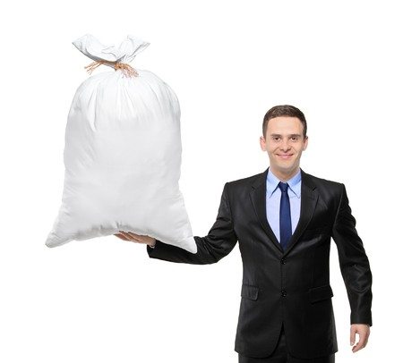 A man holsing a money bag isolated on white background photo