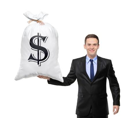 signos de pesos: Hombre de negocios feliz sosteniendo una bolsa con signo de d�lar de los Estados Unidos aislado sobre fondo blanco  Foto de archivo