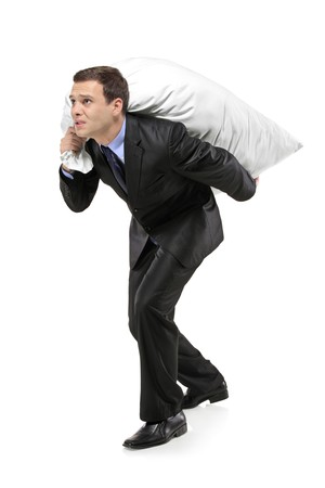 sackful: Full length portrait of a businessman carrying a money bag isolated against white background