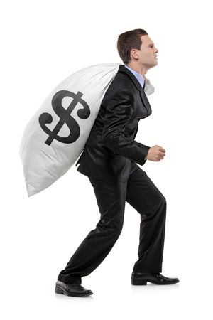 money packs: Full length portrait of a businessman carrying a money bag with US dollar sign isolated on white background