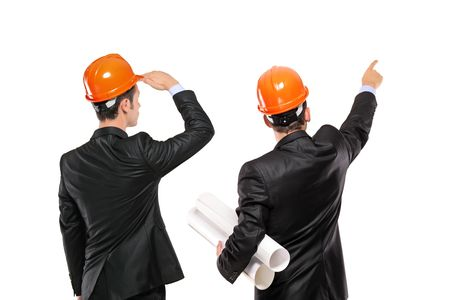 hard look: A view of two architects in a suit looking isolated on white background