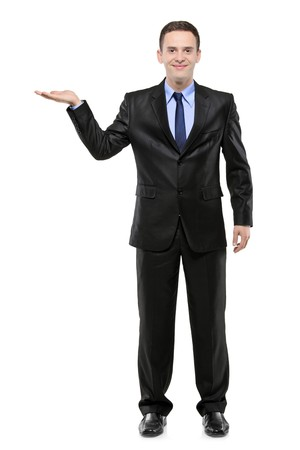 Full length portrait of a man in a suit with right hand lifted isolated against white background photo